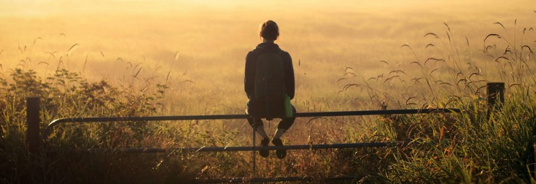 girl-backpack-thinking-sunset-field-fence-moment-field-reeds-hd-fullscreen